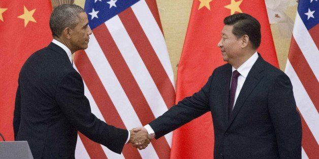 US President Barack Obama (L) and China's President Xi Jinping shake hands following a bilateral meeting  at the Great Hall o