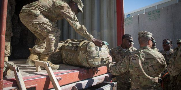 KANDAHAR, AFGHANISTAN - NOVEMBER 14:  US Army guardsmen load a lorry with their luggage as they leave at the end of their tou