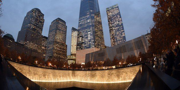One World Trade Center raises high above a reflecting pool November 13, 2014 in New York. Patrick Foye, Executive Director of
