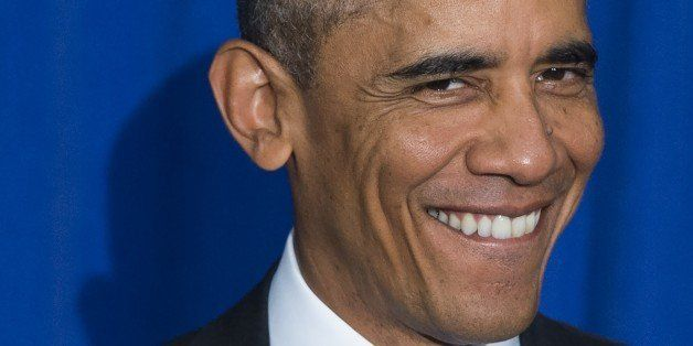 ALTERNATE CROP - US President Barack Obama smiles prior to signing an Executive Order to implement enhanced security measures