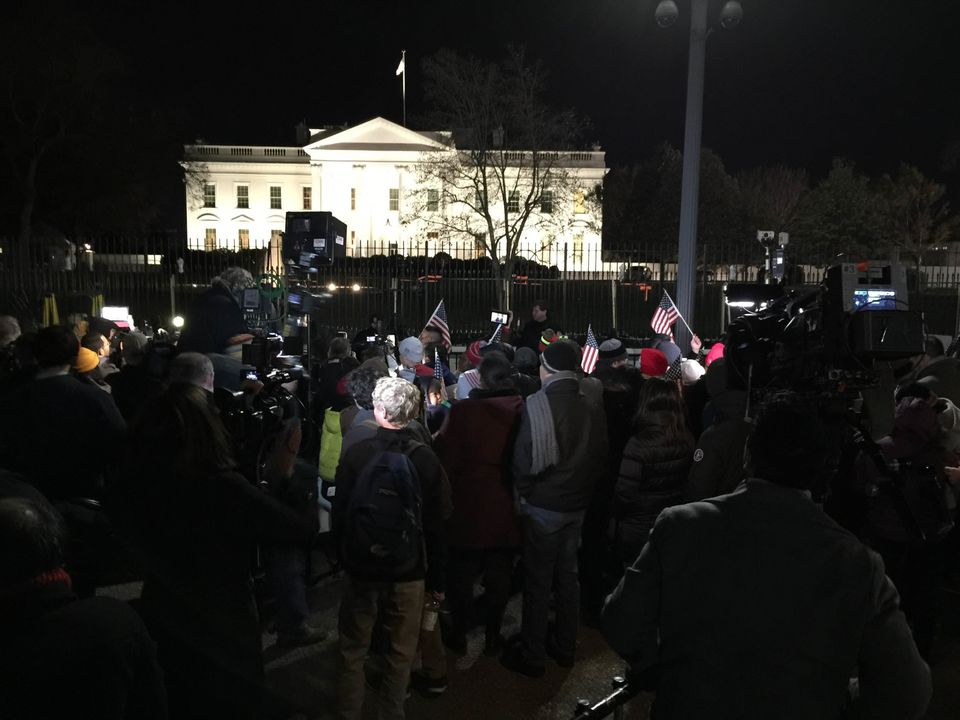 A small crowd gathered outside the White House Thursday night as President Barack Obama announced that he was taking executiv