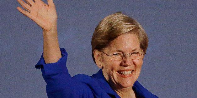 U.S. Sen Elizabeth Warren, D-Mass., waves as she takes the stage to introduce Massachusetts Democratic gubernatorial candidat