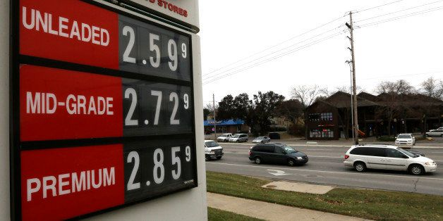 The lowest gas prices in years are seen on a fuel sign in Lawrence, Kan., Wednesday, Nov. 26, 2014. The cheapest gas in half