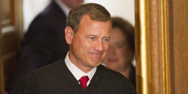 US Supreme Court Chief Justice John Roberts is followed by Elena Kagan on her way to take the Judicial Oath to become the 112
