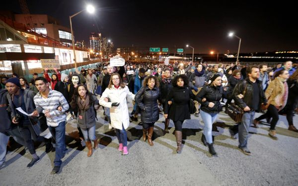 People march in protest on the West Side Highway after it was announced that the New York City police officer involved in the