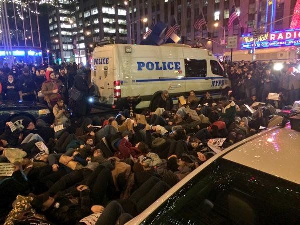 Protesters lie in the street in New York.