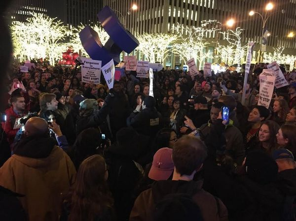 Protesters gather near Rockefeller Center in New York.