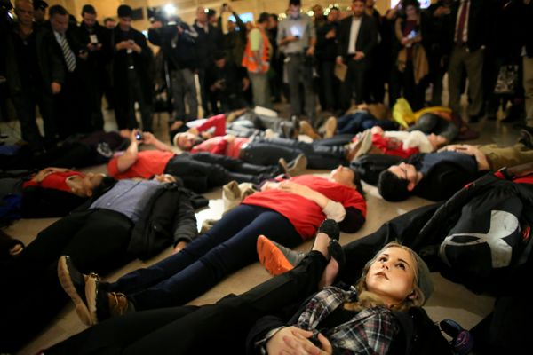 LIndsey Ellefson, 22, lies down during a protest in Grand Central Terminal December 3, 2014 in New York. Protests began after