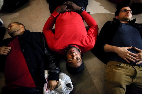 Demonstrators lie down during a protest in Grand Central Terminal December 3, 2014 in New York. Protests began after a Grand