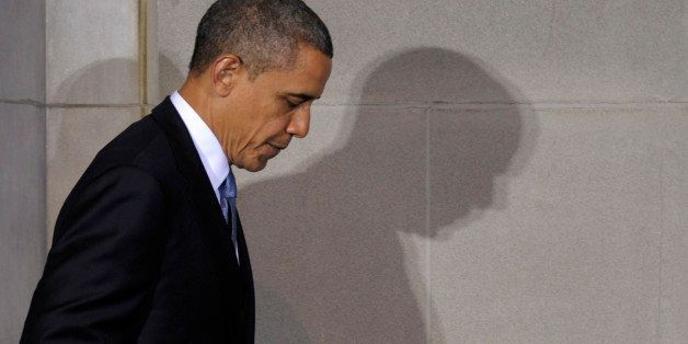 President Barack Obama casts a shadow as he walks off of the stage after speaking at the 2012 Tribal Nations Conference, Wedn