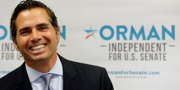 FILE - In this July 10, 2014 file photo Kansas Independent U.S. Senate candidate Greg Orman talks about launching his televis