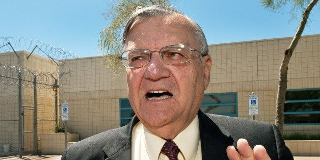 (FILES) Maricopa County Sheriff Joe Arpaio speaks with a reporter outside city jail in this May 3, 2010, file photo. The US J