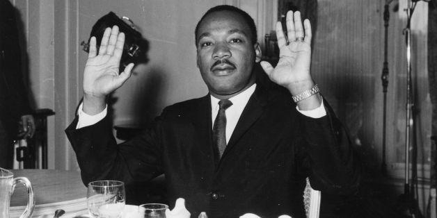 21st September 1963:  Black American civil rights leader and Baptist minister Dr Martin Luther King (1929  - 1968) raising hi