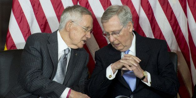 UNITED STATES - SEPTEMBER 10: Senate Majority Leader Harry Reid, D-Nev., left, speaks with Senate Minority Leader Mitch McCon