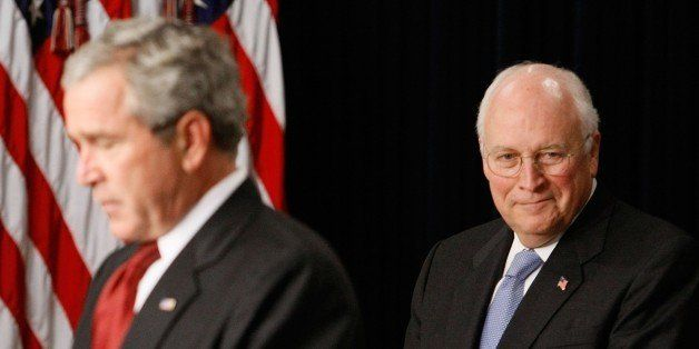 WASHINGTON - SEPTEMBER 10:  U.S. Vice President Dick Cheney (R) listens as U.S. President George W. Bush speaks during a swea