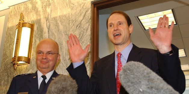 CIA Director nominee Gen. Michael Hayden, left, and Sen. Ron Wyden, D-Ore., meet with reporters on Capitol Hill Friday, May 1