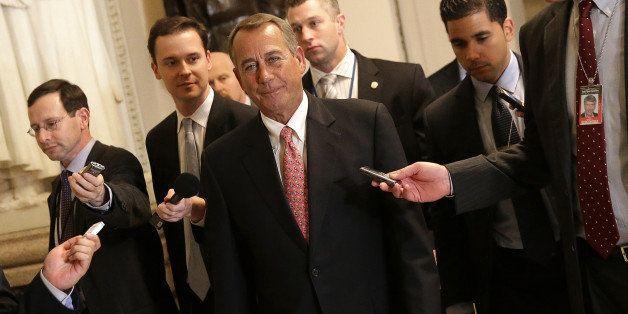 WASHINGTON, DC - DECEMBER 11:  House Speaker John Boehner (C) (R-OH) walks to the House chamber for an expected vote on a $1.