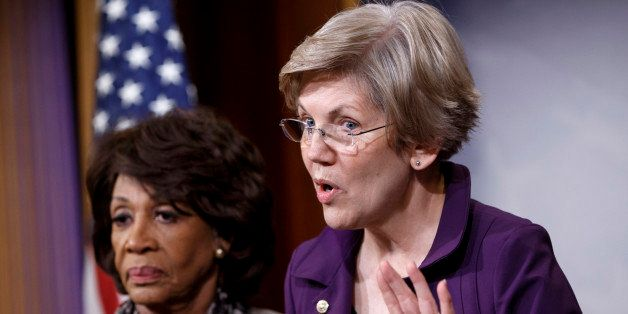 CORRECTS TO APPROVED, NOT PASSED - Sen. Elizabeth Warren, D-Mass., a member of the Senate Banking Committee, right, and Rep.