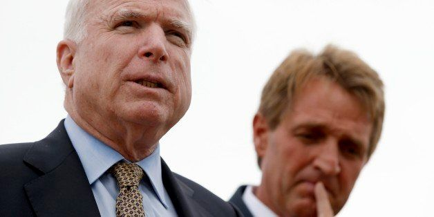 FILE - Sen. John McCain, left, R-AZ, and Sen. Jeff Flake, R-AZ, hold a news conference to discuss recent reports that dozens