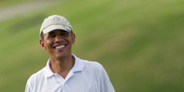 President Barack Obama plays golf at the Mid Pacific Country Club, Wednesday, .Jan. 1, 2014 in Lanikai on the island of Oahu,