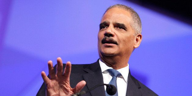 WASHINGTON, DC - OCTOBER 25:  U.S. Attorney General Eric Holder speaks  at the 18th Annual HRC National Dinner at The Walter