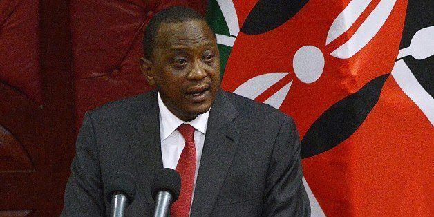 Kenyan President Uhuru Kenyatta addresses a special legislative session in parliament in Nairobi on October 6, 2014. Kenyatta