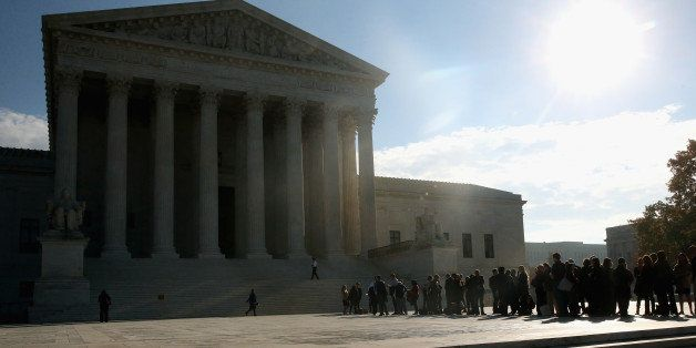 WASHINGTON, DC - NOVEMBER 12:  People stand in line to enter the US Supreme Court building, November 12, 2014 in Washington,