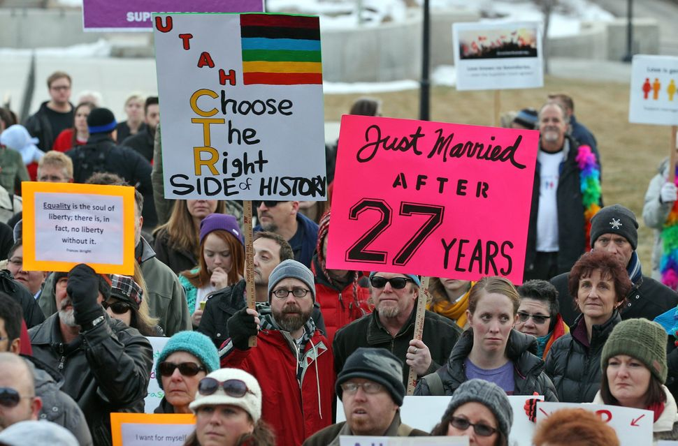Supporters of gay marriage gather for a rally at the Utah State Capitol, Tuesday, Jan. 28, 2014, in Salt Lake City.