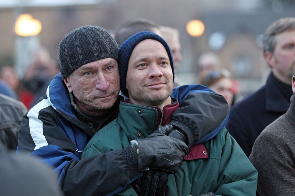 Married couple Chris Johnson, left, and David Tuma, of Ogden, Utah, hug each other during a supporters of gay marriage rally