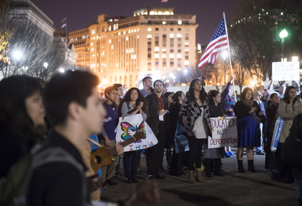 Pro-immigration demonstrators participate in a vigil to support children fleeing violence in Central America to come to the U