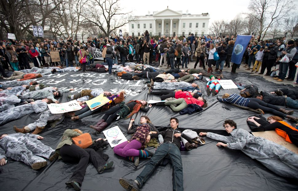 Demonstrators lie down along Pennsylvania Avenue in front of the White House during a protest against the proposed Keystone X