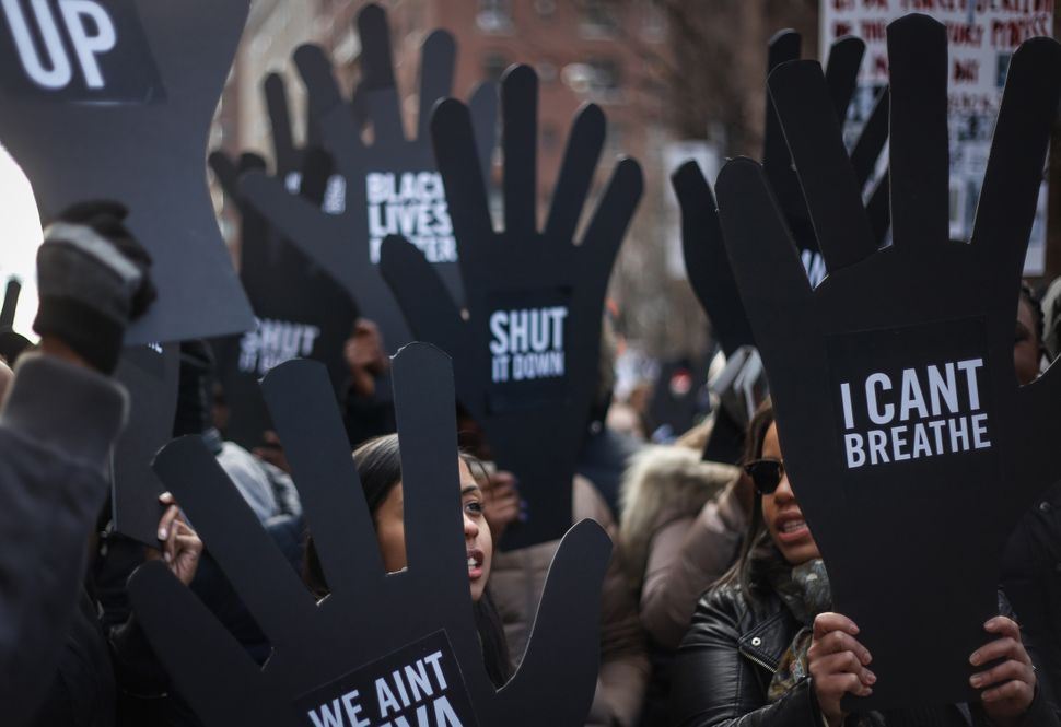 Thousands of people gather at Washington Square to march through Manhattan to protest the police violence on December 13, 201