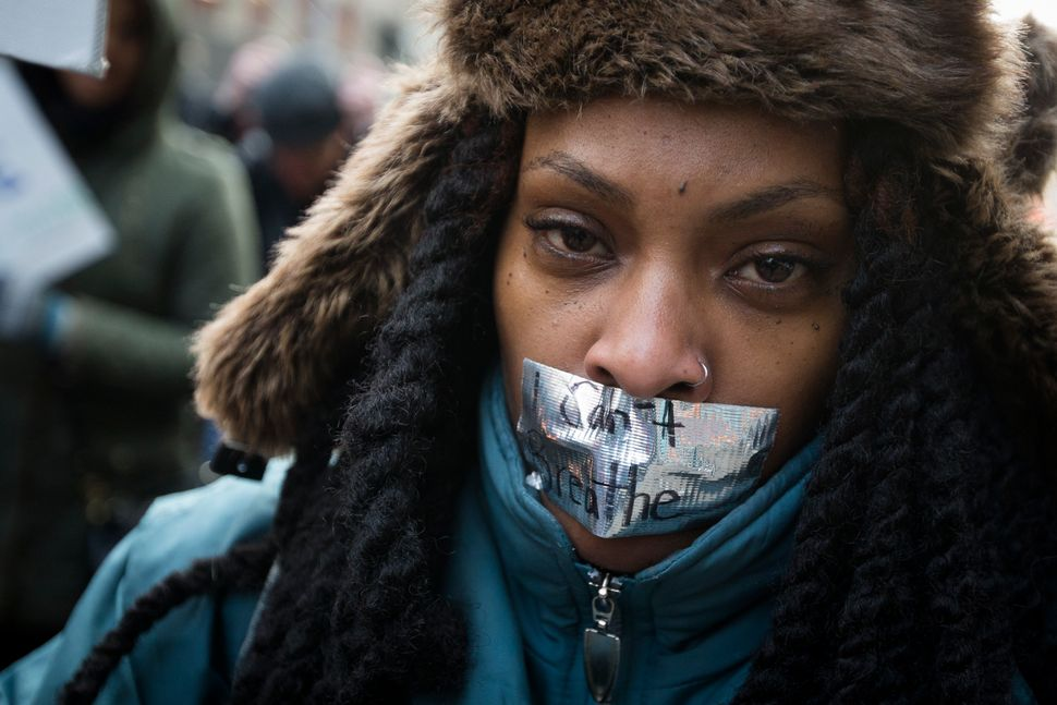 Demonstrators march in New York, Saturday, Dec. 13, 2014, during the Justice for All rally and march.