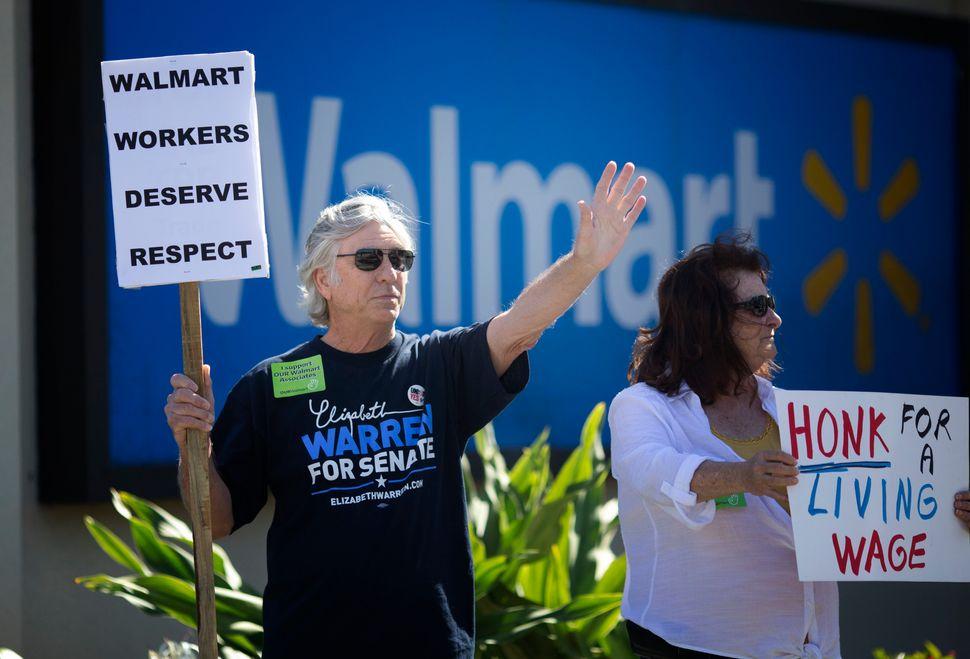 Randy and Patty Evelyn greeted Black Friday shoppers at a Boynton Beach, Florida Walmart Friday, Nov. 28, 2014.