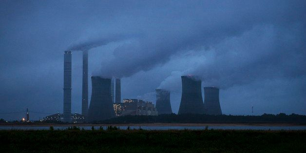 FILE- This June 1, 2014, file photo shows the coal-fired Plant Scherer in operation in Juliette, Ga. A groundbreaking agreeme