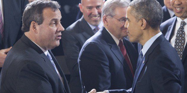US President Barack Obama shakes hands with New Jersey Governor Chris Christie (L) after speaking to US troops at Joint Base