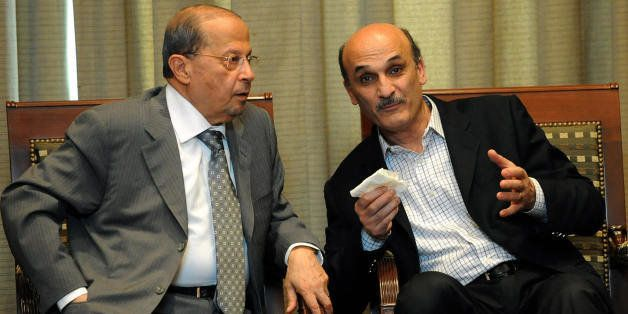 Lebanese opposition leader Michel Aoun (L) speaks with Lebanese Forces' executive committee chief, Samir Geagea at Beirut International Airport on May 16, 2008 on their way to a meeting of Lebanese leaders in Doha. Lebanon's squabbling political leaders were to meet in Qatar today for talks brokered by the Arab League aimed at ending a long-running feud that drove the country to the brink of a new civil war. AFP PHOTO/STR (Photo credit should read -/AFP/Getty Images)