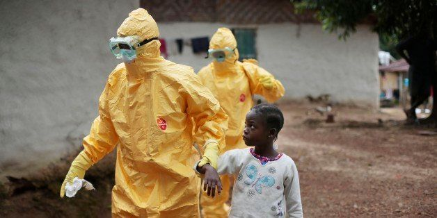 FILE - In this Sept. 30, 2014, file photo, Nine-year-old Nowa Paye is taken to an ambulance after showing signs of the Ebola