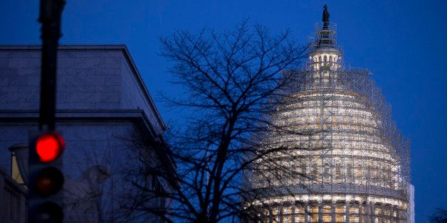 Scaffolding surrounds the U.S. Capitol Building Dome before sunrise in Washington, D.C., U.S., on Wednesday, Dec. 10, 2014. C