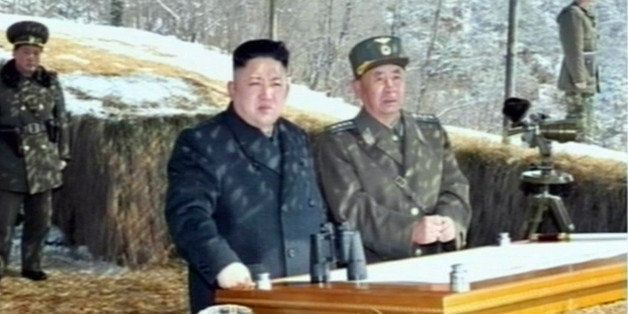 This video grab taken from North Korean TV on March 20, 2013 shows North Korean leader Kim Jong-Un's overseeing a live fire m