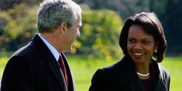 WASHINGTON - NOVEMBER 17:  (AFP OUT) U.S. President George W. Bush (L) walks with Secretary of State Condoleezza Rice after a