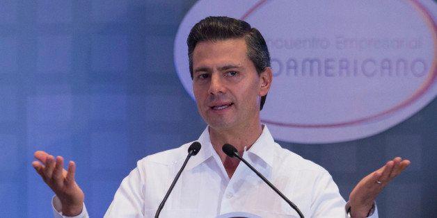 VERACRUZ, MEXICO - DECEMBER 07: Mexican President Enrique Peña Nieto delVIers a speech during a meeting with businessmen as