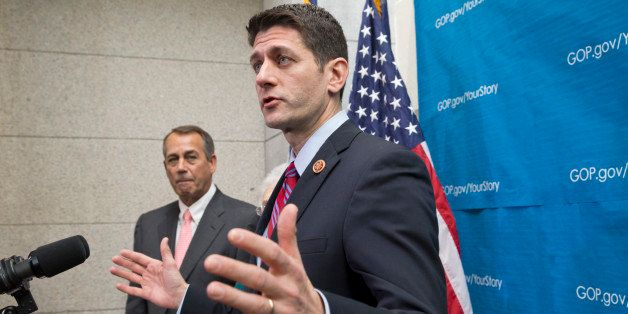 House Budget Committee Chairman Rep. Paul Ryan, R-Wis., right, accompanied by House Speaker John Boehner of Ohio, left, takes