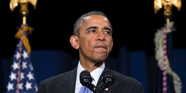 President Barack Obama pauses as he speaks about the Senior Executive Service, composed of the senior leadership of the Feder