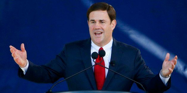 Republican Arizona Gov. Doug Ducey addresses the crowd after being sworn in during inauguration ceremonies at the Arizona Capitol Monday, Jan. 5, 2015, in Phoenix. (AP Photo/Ross D. Franklin)