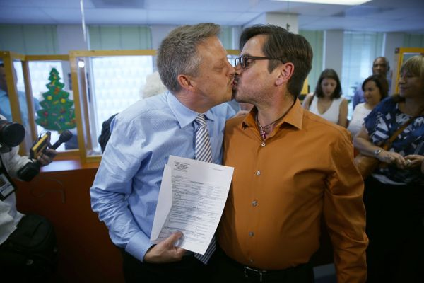 Don Johnston and Jorge Diaz kiss after obtaining their marriage license from the Miami-Dade Clerk of Courts Monday.