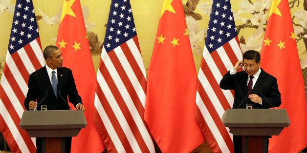 U.S. President Barack Obama, left, and Chinese President Xi Jinping arrive for their joint press conference at the Great Hall of the People in Beijing Wednesday, Nov. 12, 2014. (AP Photo/Andy Wong)