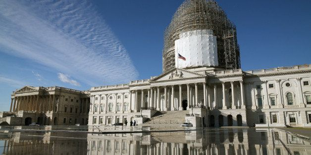 WASHINGTON, DC - JANUARY 05: The US Capitol is  reflected in a fountain, January 5, 2015 in Washington, DC. Tomorrow Congress