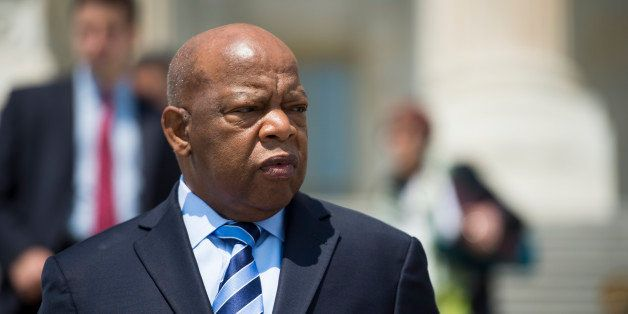 UNITED STATES - JULY 11: Rep. John Lewis, D-Ga., leaves the Capitol following a vote on Friday, July 11, 2014. (Photo By Bill