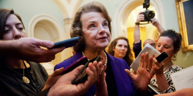 UNITED STATES - DECEMBER 09: Sen. Dianne Feinstein, D-Calif., Chairwoman of the Senate Intelligence Committee, talks with rep